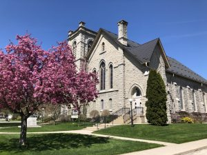Church building with tree in Spring blossoms